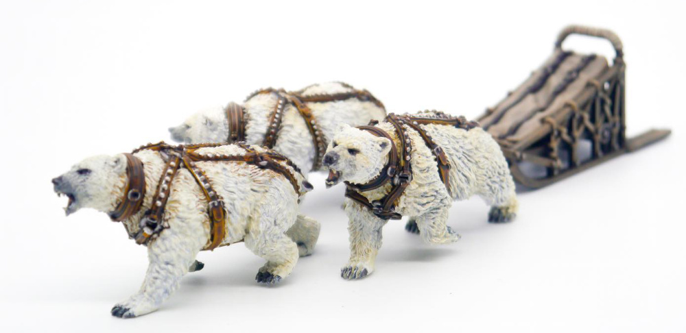 Miniature dog sled pulled by polar bears