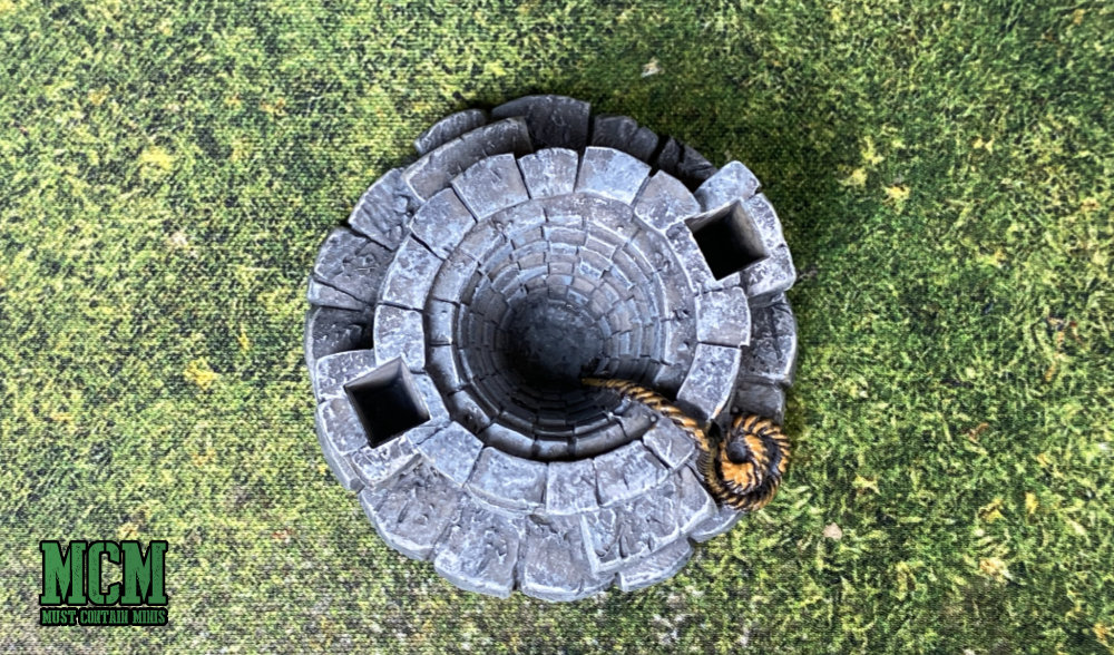 An optical illusion to make the terrain piece look like it has a deeper pit than it really does - miniature gaming terrain