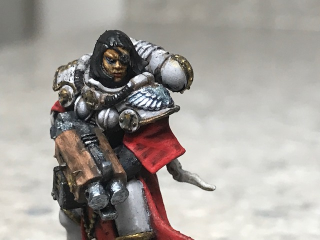 A Sister of Battle with a Storm Bolter