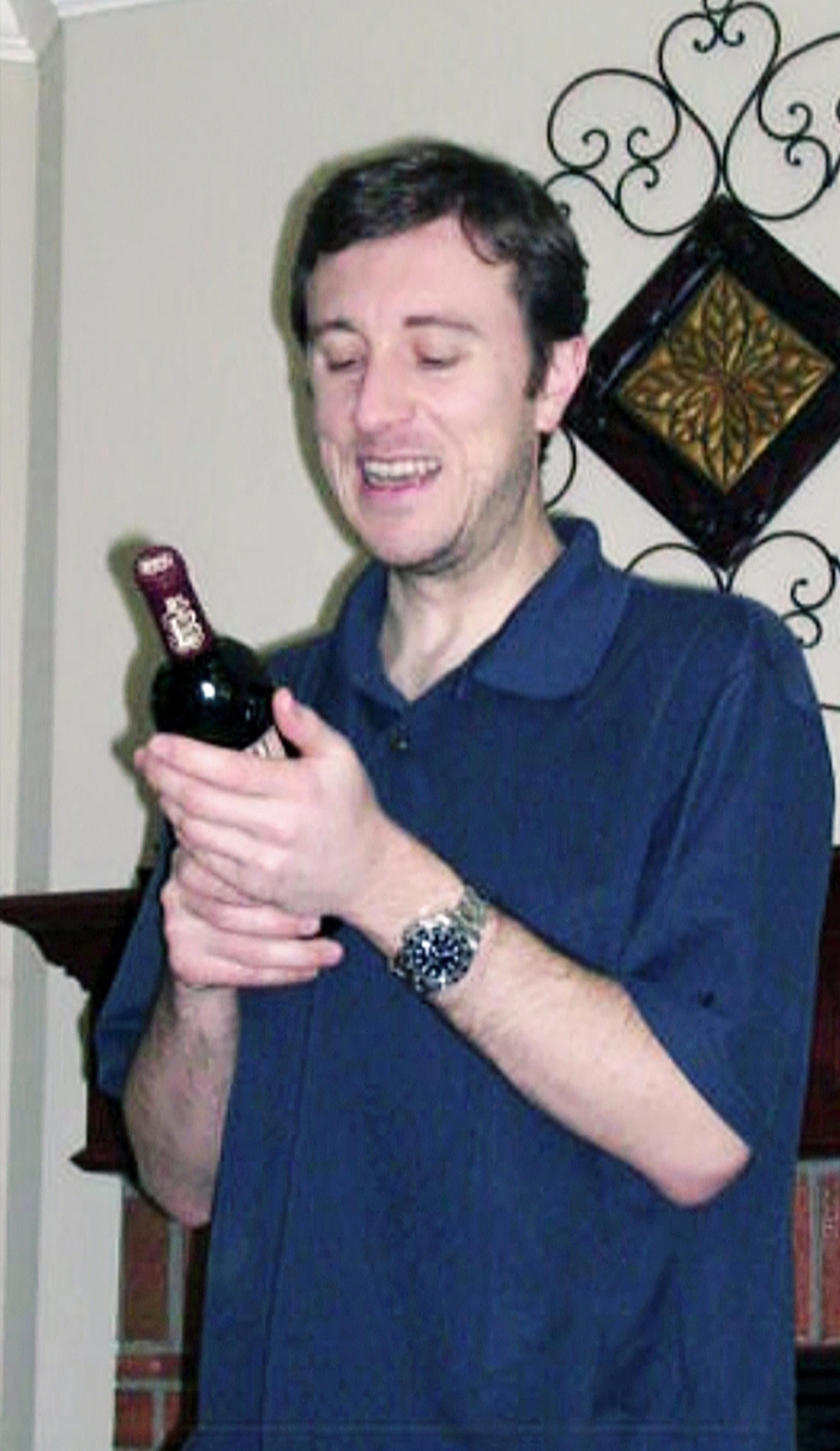 """Michael """"MJ The Terrible"""" Johnson Holding An Expensive Bottle of Red Wine"""