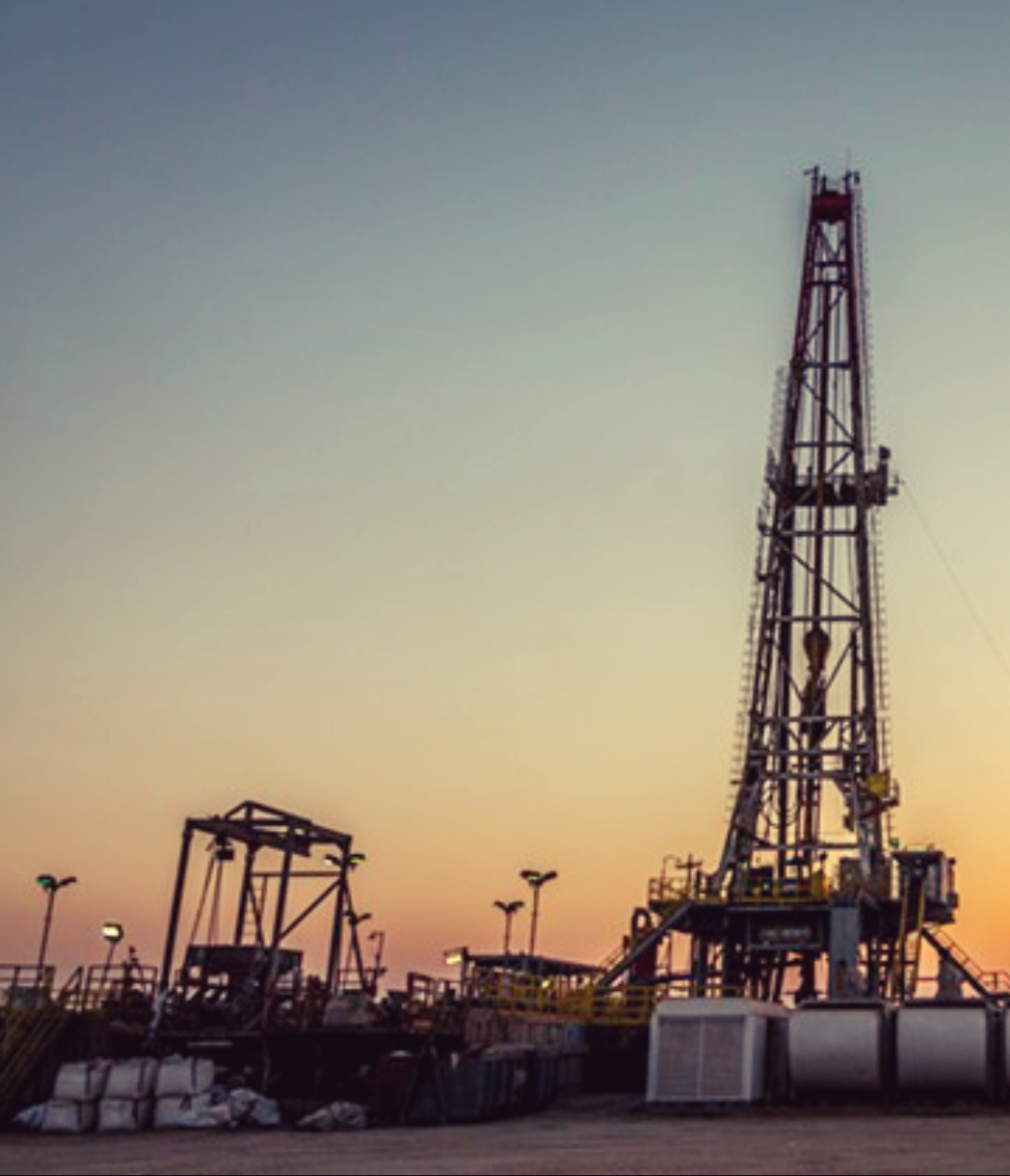 Oil Drilling Rig & Equipment Photo At Dusk