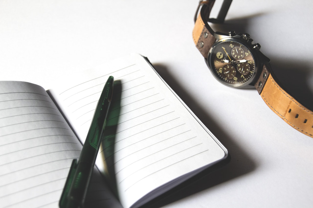 to-do checklist with pen watch notepad for new website