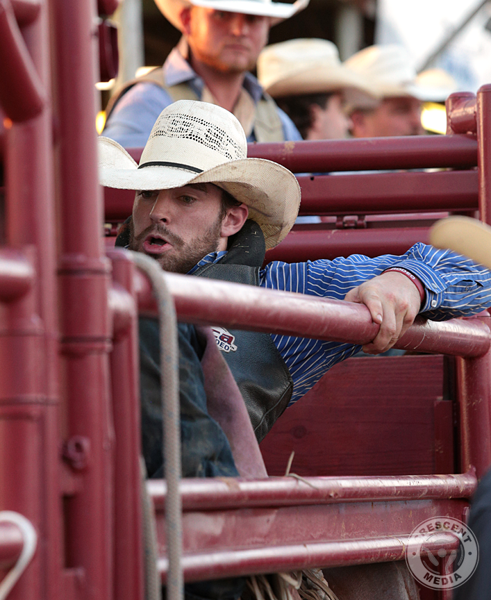 North Texas Fair and Rodeo Cowboy settles in the chute.