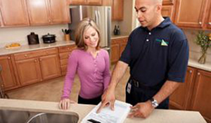 ServiceMaster employee speaking to a customer