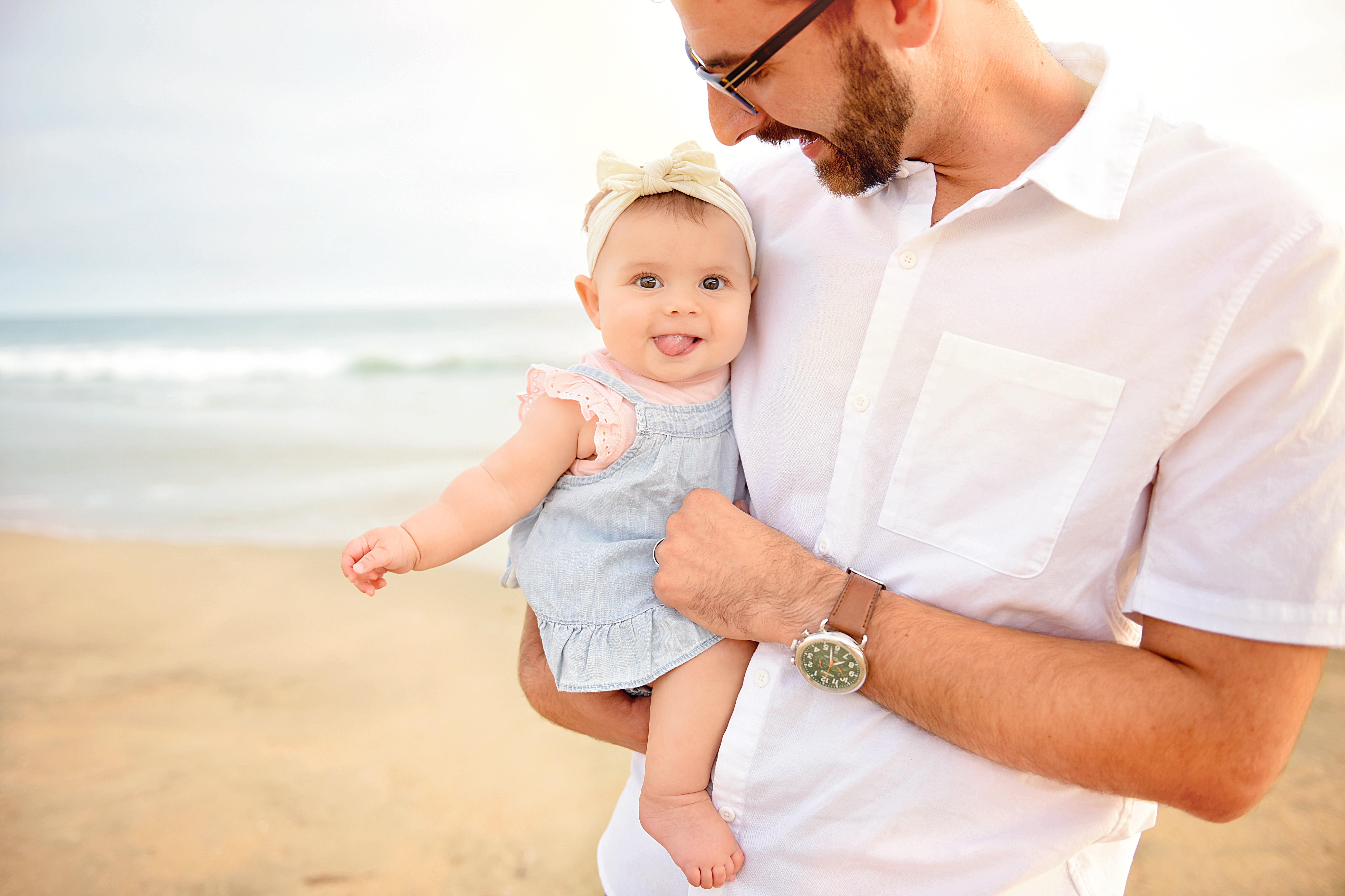 Daddy holding daughter | family portraits