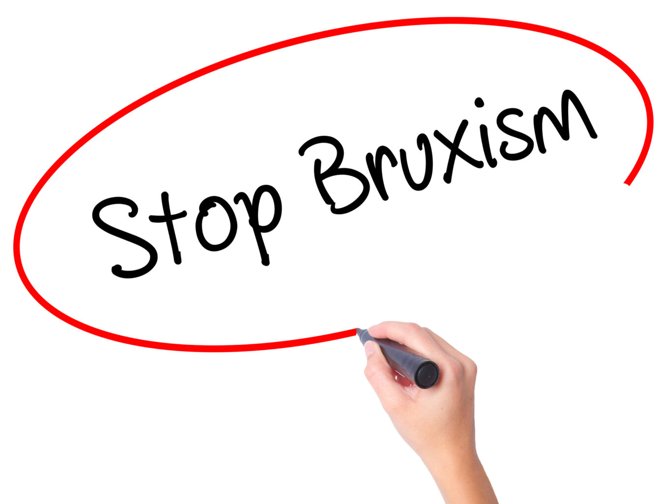"woman writing ""stop bruxism"""