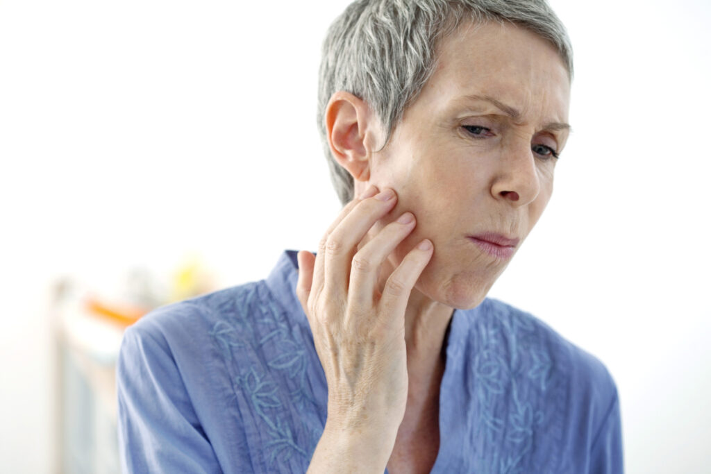 older woman with jaw pain