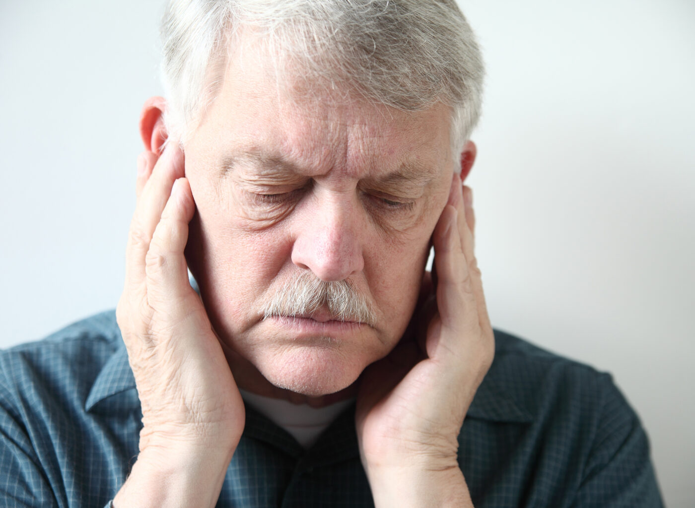 older man with TMJ pain
