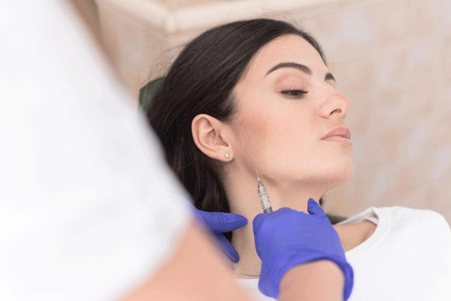 woman getting BOTOX injections in jaw