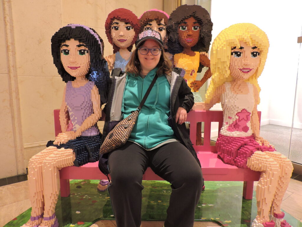A CIP Tour member hanging with full size lego characters at Legoland