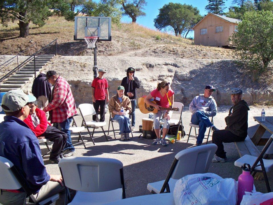 UCP Members at a music circle at Camp Kelley Creek