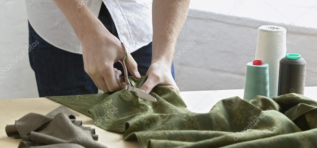 depositphotos_33887851-stock-photo-tailor-cutting-fabric