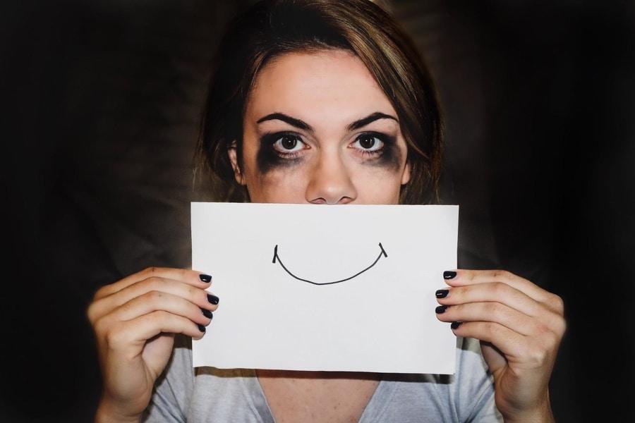 woman-burnout-smiley-face-control
