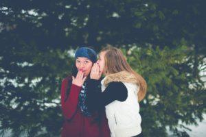 two women sharing secrets