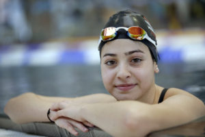 FILE - This is a Monday, Nov. 9, 2015 file photo of Yusra Mardini from Syria poses during a training session in Berlin, Germany. They've fled war and violence in the Middle East and Africa. They've crossed treacherous seas in small dinghies and lived in dusty refugee camps.They include a teenage swimmer Yusra Mardini from Syria, long-distance runners from South Sudan and judo and taekwondo competitors from Congo, Iran and Iraq. They are striving to achieve a common goal: To compete in the Olympics in Rio de Janeiro. Not for their home countries, but as part of the first ever team of refugee athletes.(AP Photo/Michael Sohn, File)