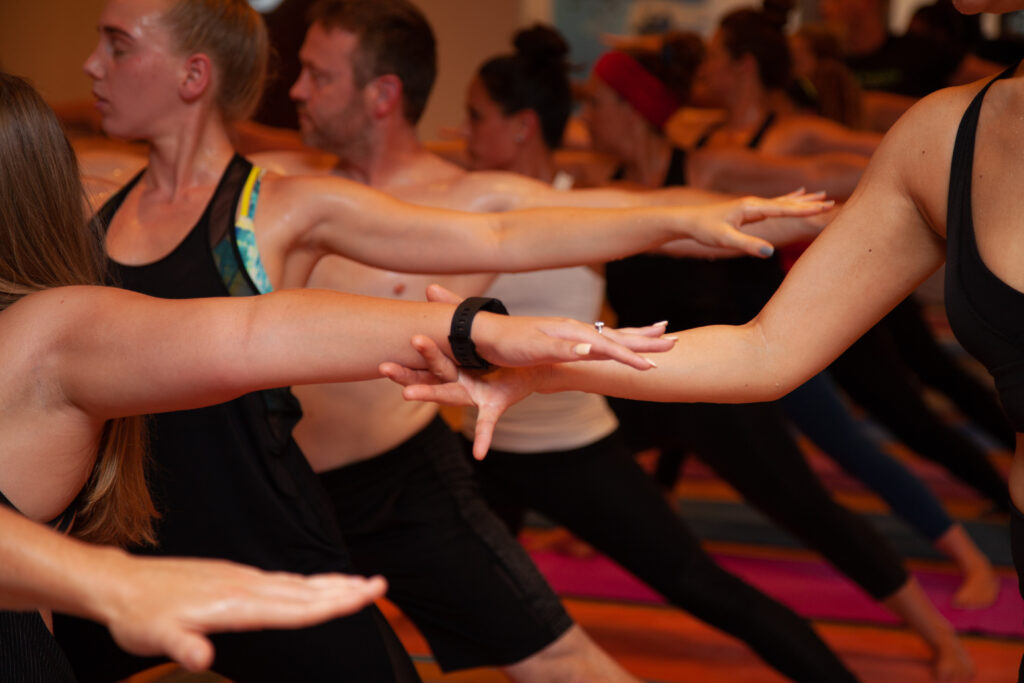 © Sol Hot Yoga Studio_Warrior2 Guiding Hand
