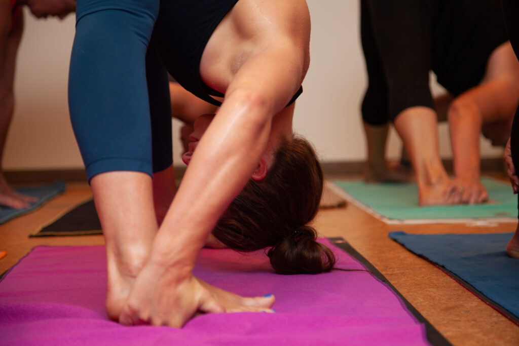 © Sol Hot Yoga Studio_Standing Separate Leg Stretching
