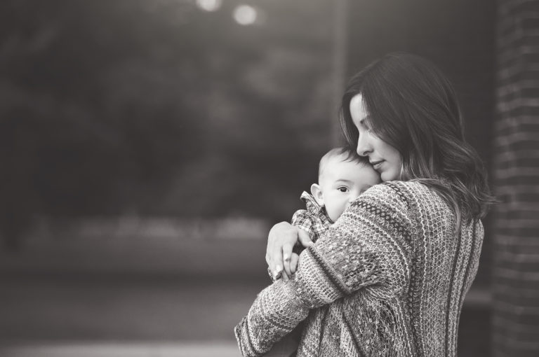 black and white photo of mother and baby