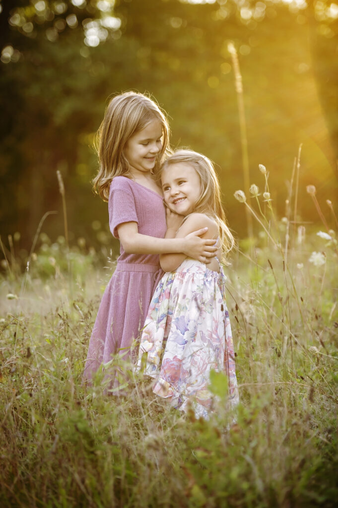 outdoor photo of two little girls during family photoshoot in Saratoga Springs NY