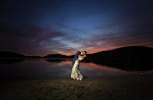 sunset wedding photo kiss