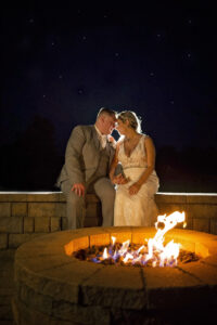 nighttime photo of bride and groom