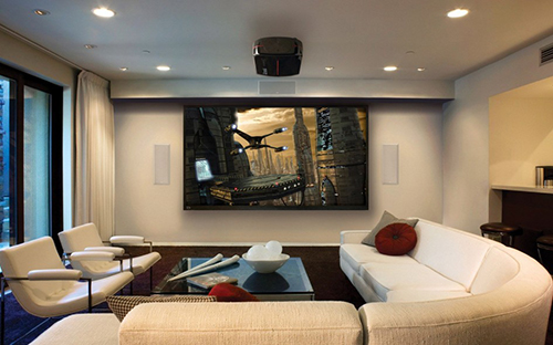 premium home theater with in wall speakers and projector