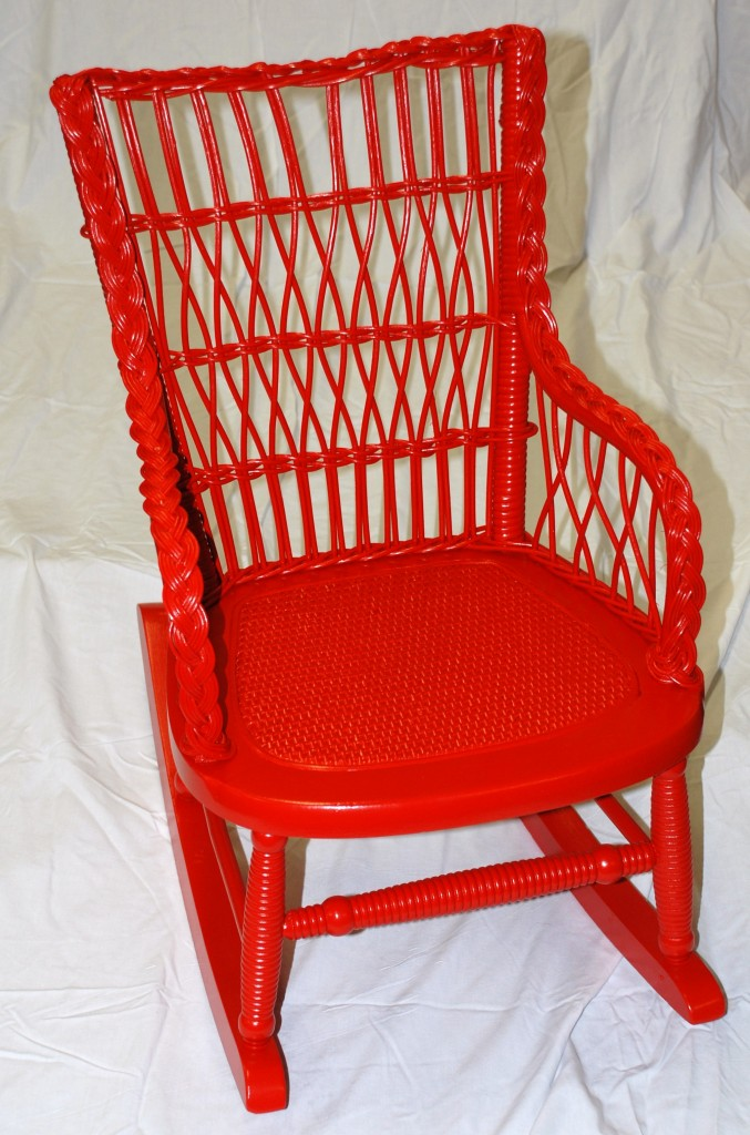 Child's wicker chair painted bright red after we restored it