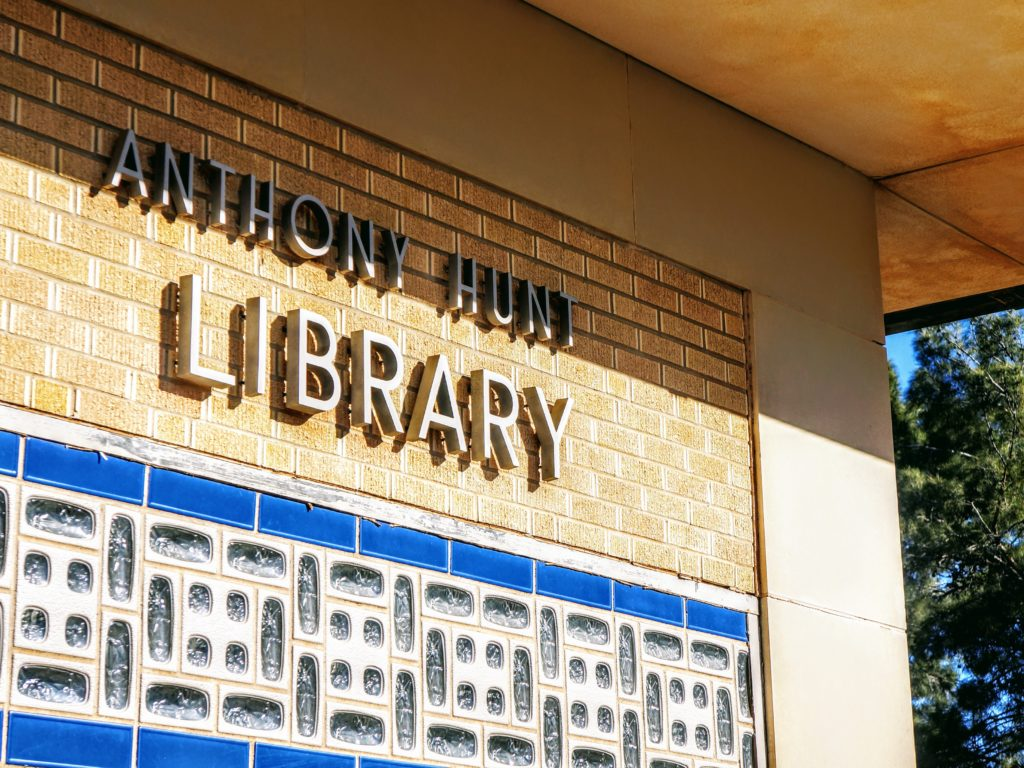 """Letters on exterior wall of library spell """"Anthony Hunt Library"""""""
