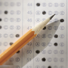 Sharpened pencil laying on test paper