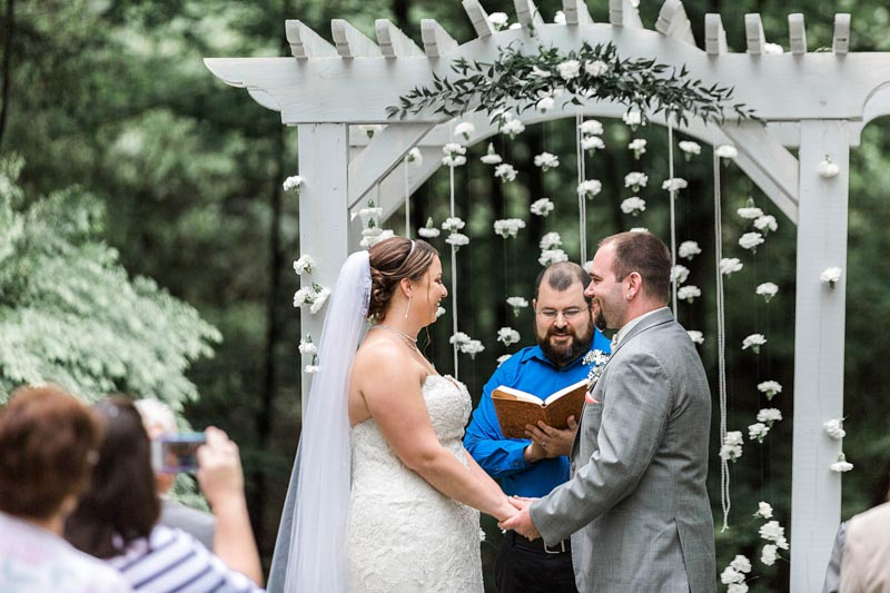 Bride and Groom Outside Exchanging Vows