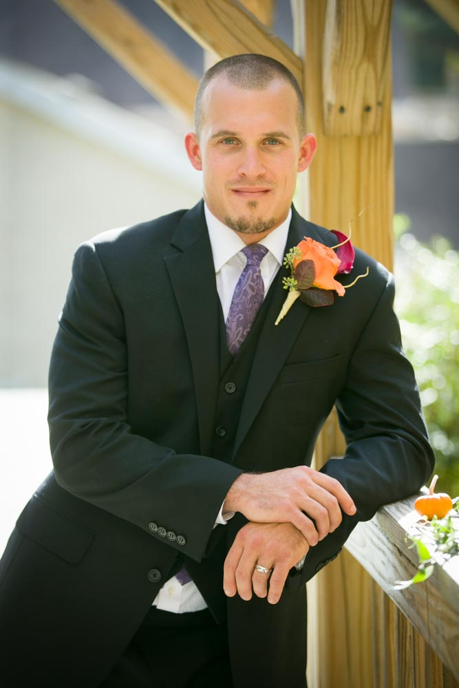 Groom Standing Against the wall