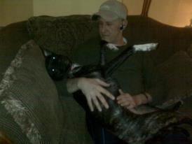 Dog and man hugging