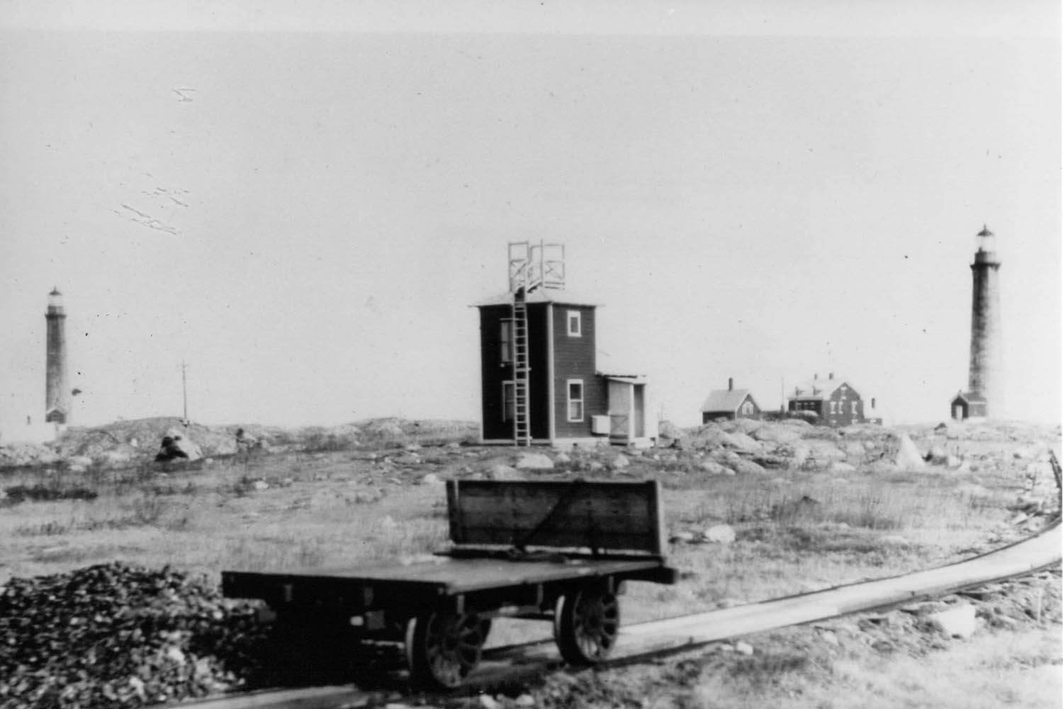 Coal cart near the radio compass tower operated by the U.S. Navy c.1911.