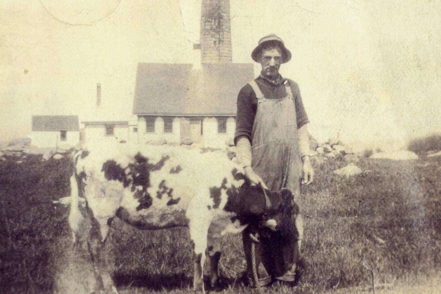 Keeper William Daggett (1870-1945) tending his cow near the North tower c.1918.