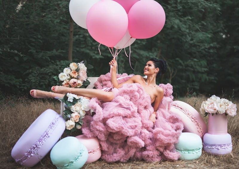 Fashion-sexy-woman-dressed-in-pink-stunning-dress-surrounded-of-French-Macarons-cm