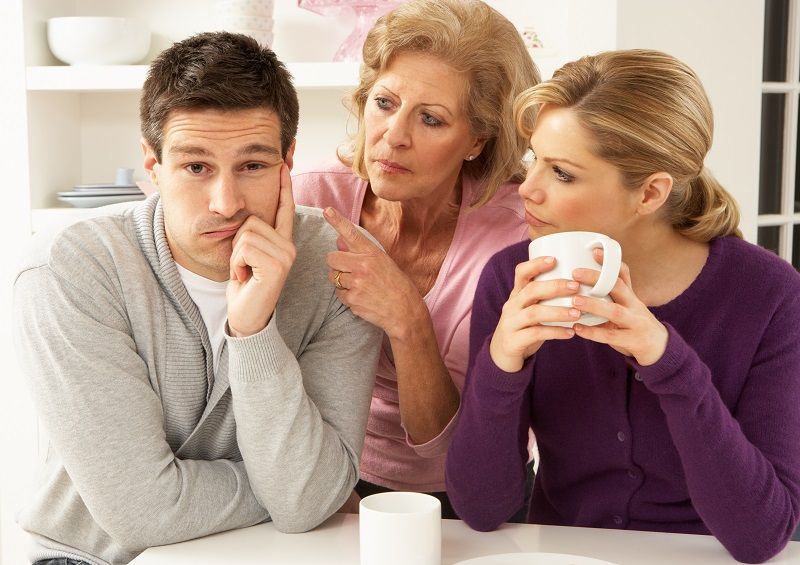 Older-woman-in-between-young-woman-and-young-man--cm