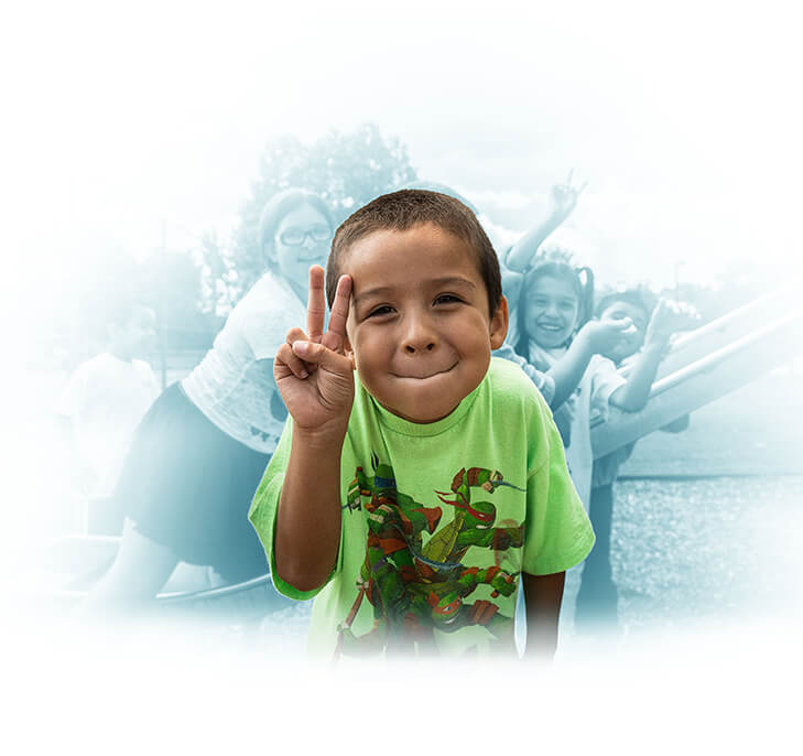 Child Smiling Peace Sign Playground