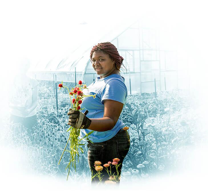 Woman gardening holding flowers