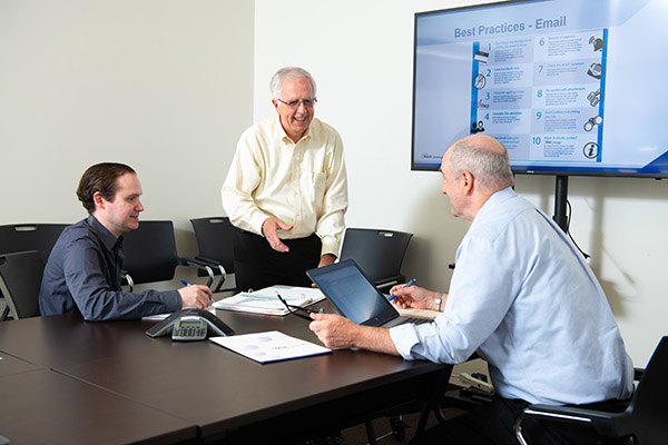 A NetCenergy employee presenting a report and serving as a client's trusted IT business partner