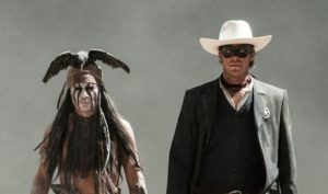 """""""THE LONE RANGER"""" L to R: Johnny Depp as Tonto and Armie Hammer as The Lone Ranger Ph: Peter Mountain ©Disney Enterprises, Inc. and Jerry Bruckheimer Inc. All Rights Reserved."""
