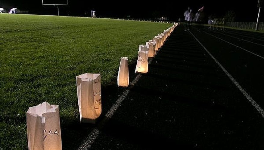 Candles lit for the annual Candle Light Relay track workout