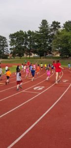 Kids running track.  Because that never gets old.