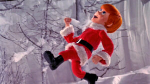 Kris Kringle running up the Mountain of the Whispering Winds