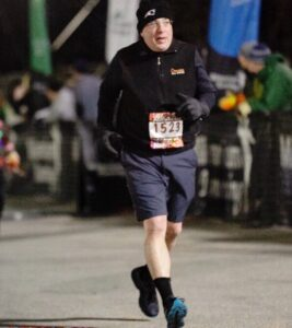 Bob at the finish line of the Yule Light Up the Night race