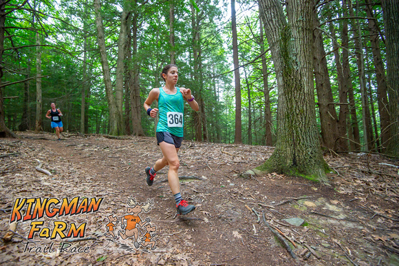 Amanda running Kingman Farm Trail Race in 2019
