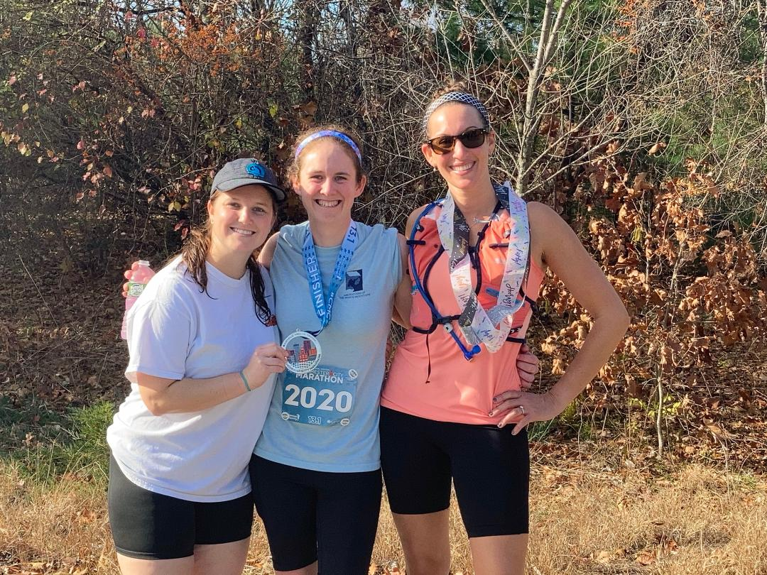A very tired smile with my awesome two running buddies (Taylor and Tara) who supported me during my half