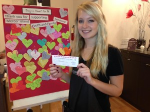 Sara beside our Giving From the Heart event poster