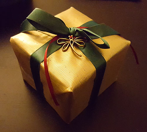 box wrapped in gold cloth