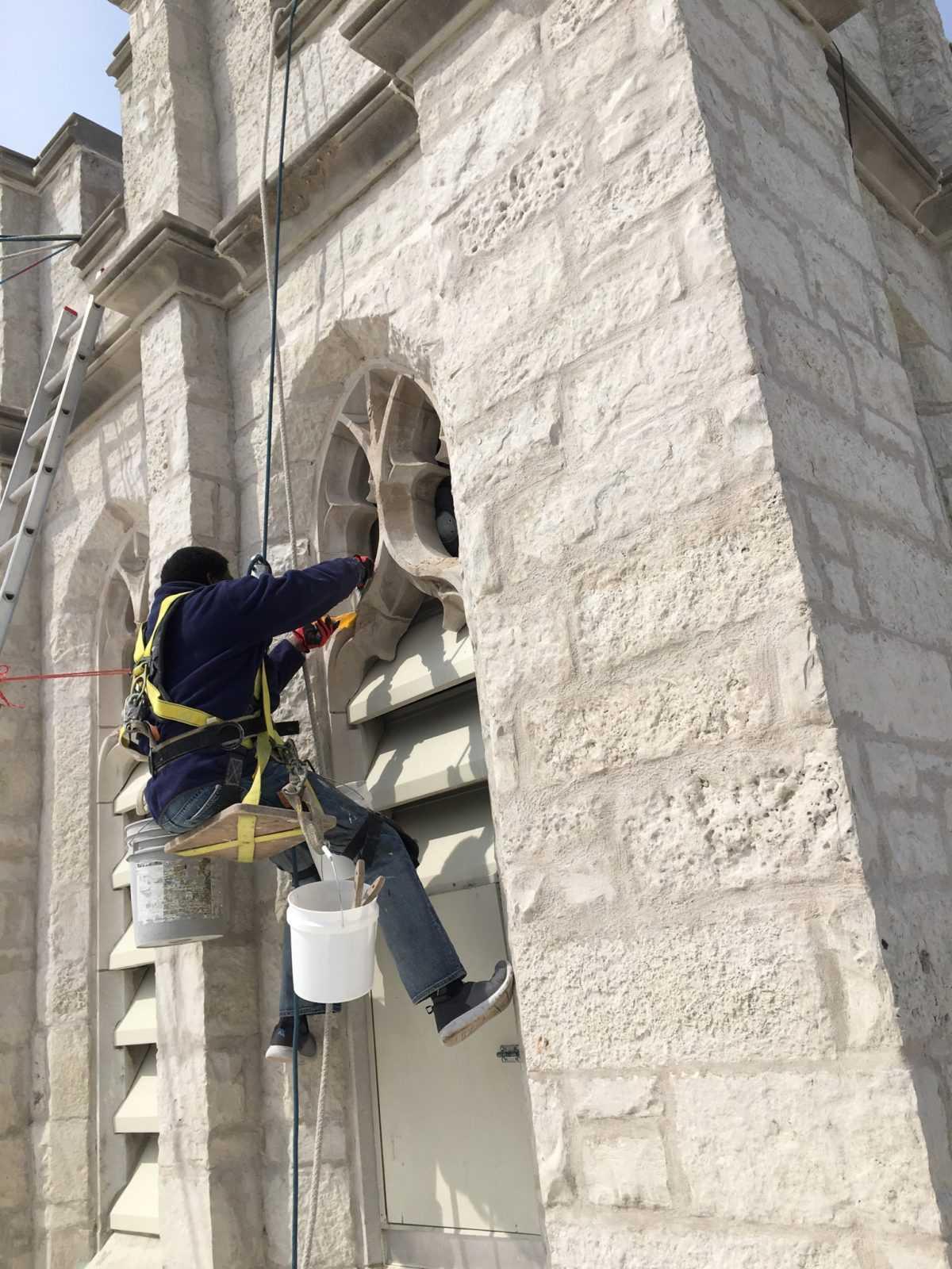 Steeplejack working on tower