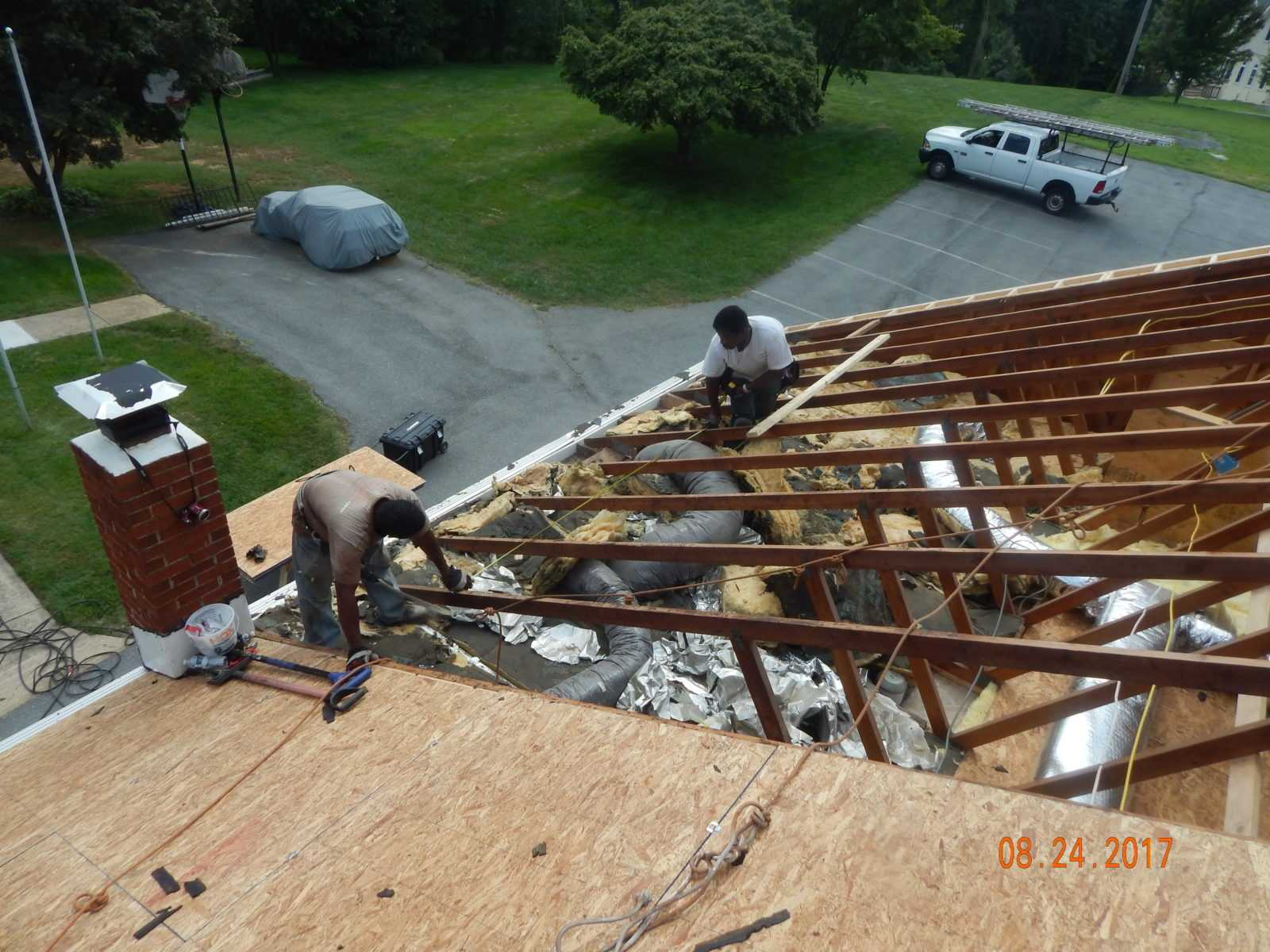 Roofers replacing church roof deck